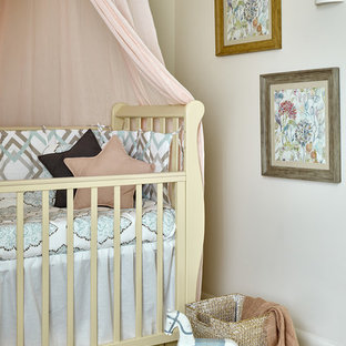 Small eclectic gender neutral nursery in Moscow with beige walls.