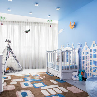 This is an example of a medium sized contemporary nursery for boys in Moscow with cork flooring, blue walls and multi-coloured floors.