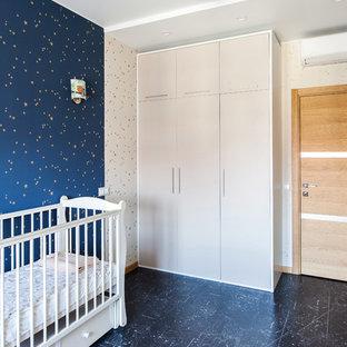 Modelo de habitación de bebé actual con paredes azules y suelo azul