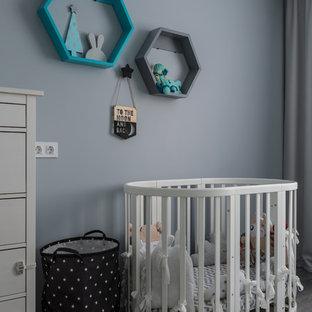 На фото: комнаты для малыша в стиле современная классика с синими стенами и серым полом для мальчика
