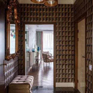 На фото: маленький коридор в современном стиле с мраморным полом, коричневыми стенами и черным полом с