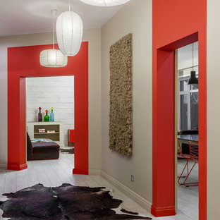 Design ideas for a mid-sized eclectic hallway in Other with beige walls, ceramic floors and beige floor.