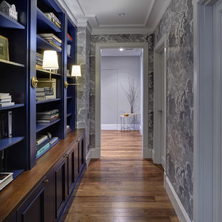This is an example of a contemporary hallway in Moscow with medium hardwood floors, brown floor and multi-coloured walls.