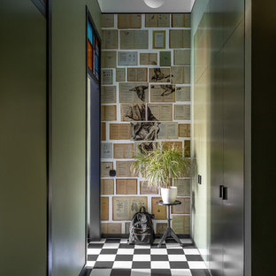 На фото: маленький коридор в стиле фьюжн с зелеными стенами, полом из керамогранита и разноцветным полом с