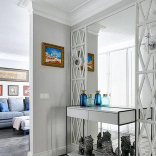 На фото: коридоры в стиле современная классика с серыми стенами и серым полом