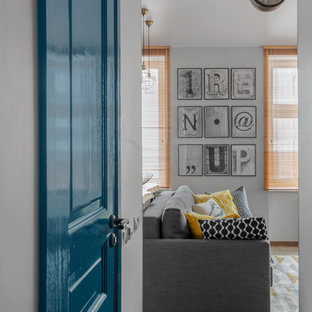 Inspiration for a contemporary hallway remodel in Other with gray walls