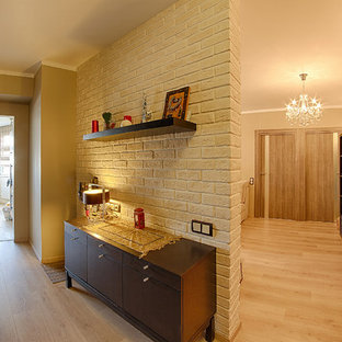 Hallway - mid-sized contemporary laminate floor hallway idea in Moscow with beige walls