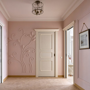 Example of a transitional beige floor hallway design in Other with pink walls
