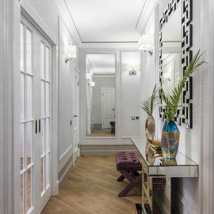 На фото: коридор в стиле современная классика с белыми стенами, паркетным полом среднего тона и коричневым полом с