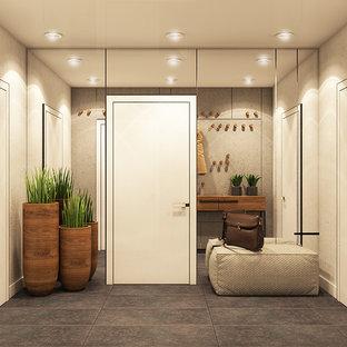 Idéer för små funkis hallar, med grå väggar, betonggolv och grått golv