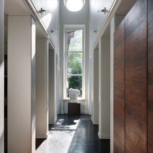 Midcentury hallway in Moscow with white walls and black floor.