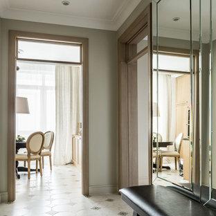 На фото: коридоры в стиле современная классика с серыми стенами, полом из керамогранита и белым полом
