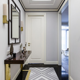 Inspiration for a contemporary multicolored floor hallway remodel in Moscow with white walls
