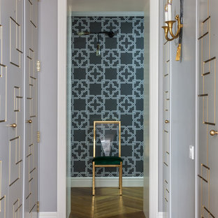На фото: коридор в стиле современная классика с серыми стенами, паркетным полом среднего тона и коричневым полом с