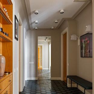 На фото: коридор в стиле современная классика с серыми стенами, бирюзовым полом и многоуровневым потолком с