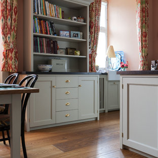 Large country l-shaped open plan kitchen in Cologne with a double-bowl sink, shaker cabinets, beige cabinets, granite benchtops, pink splashback, subway tile splashback, coloured appliances, medium hardwood floors and with island.