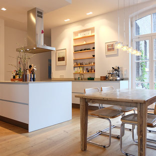 Large Modern Open Concept Kitchen Appliance   Inspiration For A Large  Modern Medium Tone Wood Floor