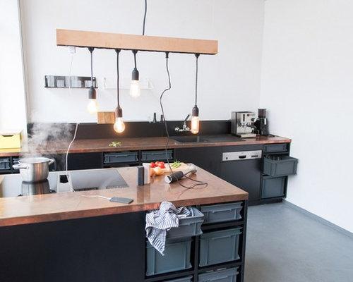 cuisine avec un plan de travail en cuivre et b ton au sol photos et id es d co de cuisines. Black Bedroom Furniture Sets. Home Design Ideas