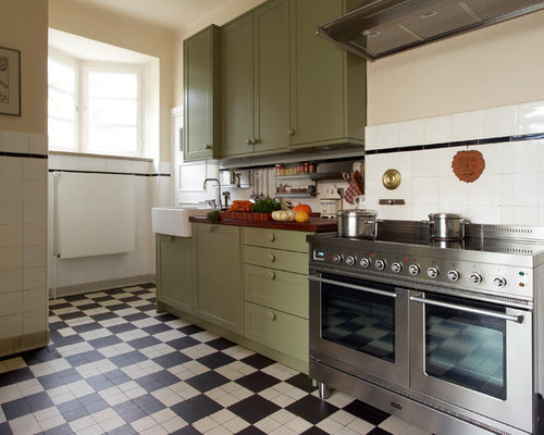 Example Of A Country Ceramic Floor And Multicolored Floor Enclosed Kitchen  Design In Hamburg With A