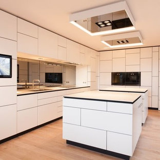 Large Contemporary Eat In Kitchen Ideas   Example Of A Large Trendy Galley  Light Wood