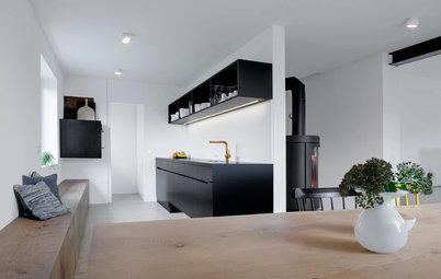 Minimalistisch und trotzdem warm: eine graue küche in köln