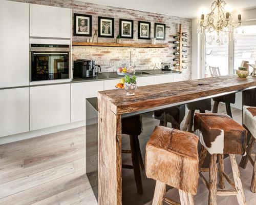 Küche mit Küchenrückwand in Braun - Ideen & Bilder