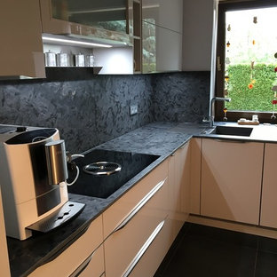Design ideas for a mid-sized contemporary l-shaped separate kitchen in Leipzig with an integrated sink, granite benchtops, blue splashback, no island and blue benchtop.
