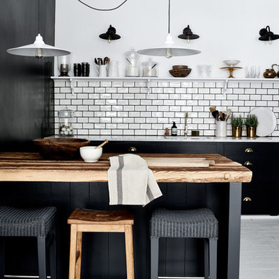 Large trendy galley painted wood floor open concept kitchen photo in Dusseldorf with white backsplash, subway tile backsplash, an island and a single-bowl sink