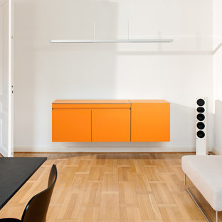 Inspiration for a small contemporary single-wall eat-in kitchen in Dusseldorf with a drop-in sink, orange cabinets, white splashback and no island.