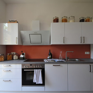 Photo of a small contemporary single-wall separate kitchen in Other with a drop-in sink, flat-panel cabinets, white cabinets, laminate benchtops, glass sheet splashback, stainless steel appliances, marble floors, no island and white floor.