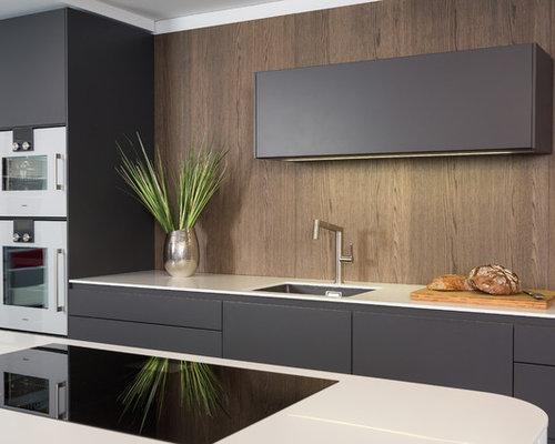 Linoleum Frankfurt kitchen with wood splashback and lino flooring design ideas