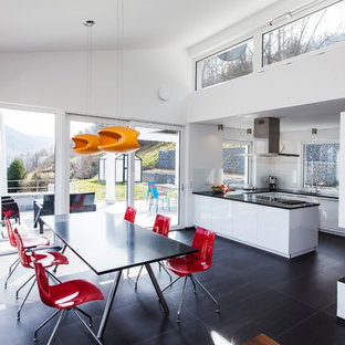 Inspiration for a large contemporary u-shaped open plan kitchen in Munich with an integrated sink, flat-panel cabinets, white cabinets, white splashback, stainless steel appliances, onyx benchtops and no island.