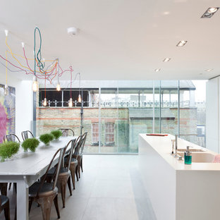 Trendy galley eat-in kitchen photo in London with an integrated sink, flat-panel cabinets, white cabinets and blue backsplash