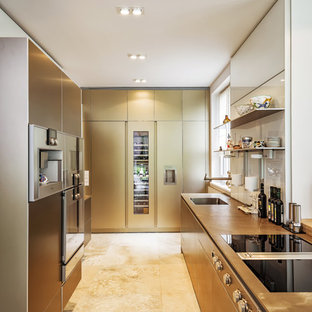 Design ideas for a large contemporary u-shaped open plan kitchen in Berlin with an undermount sink, flat-panel cabinets, beige cabinets, limestone benchtops, white splashback, glass sheet splashback, stainless steel appliances, limestone floors, a peninsula, beige floor and brown benchtop.