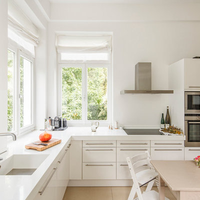 Large trendy l-shaped eat-in kitchen photo in Cologne with flat-panel cabinets, white cabinets and an integrated sink