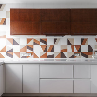 Inspiration for a mid-sized contemporary u-shaped open plan kitchen in Moscow with an integrated sink, flat-panel cabinets, white cabinets, solid surface benchtops, multi-coloured splashback, ceramic splashback, panelled appliances, vinyl floors, no island and beige floor.