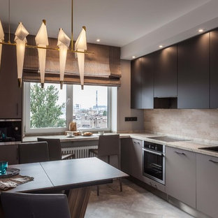 Photo of a contemporary l-shaped eat-in kitchen in Saint Petersburg with a drop-in sink, flat-panel cabinets, black cabinets, beige splashback, stainless steel appliances, grey floor and beige benchtop.