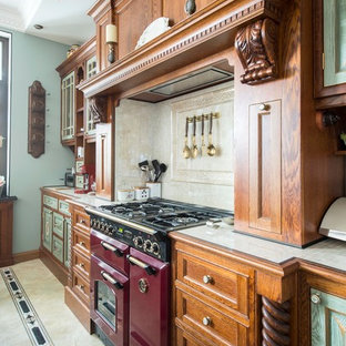 Design ideas for a mid-sized victorian u-shaped open plan kitchen in Moscow with raised-panel cabinets, tile benchtops, beige splashback, ceramic splashback, coloured appliances, ceramic floors, with island, beige floor and medium wood cabinets.