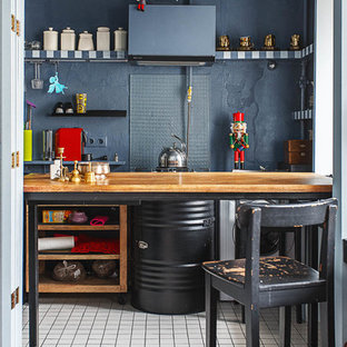 Eclectic kitchen pictures - Kitchen - eclectic kitchen idea in Moscow with open cabinets and black backsplash