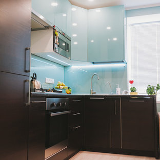 Photo of a mid-sized contemporary l-shaped eat-in kitchen in Other with a drop-in sink, turquoise cabinets, laminate benchtops, glass tile splashback, stainless steel appliances and laminate floors.
