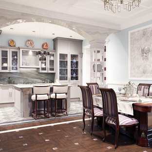 This is an example of a large traditional single-wall eat-in kitchen in Saint Petersburg with glass-front cabinets, grey cabinets, granite benchtops, with island and green benchtop.