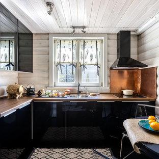 Идея дизайна: отдельная, угловая кухня среднего размера в стиле кантри с накладной раковиной, плоскими фасадами и черными фасадами