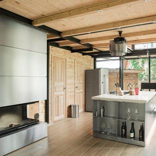 Неиссякаемый источник вдохновения для домашнего уюта: кухня-гостиная среднего размера в современном стиле с плоскими фасадами, кухней из нержавеющей стали, островом и белой столешницей