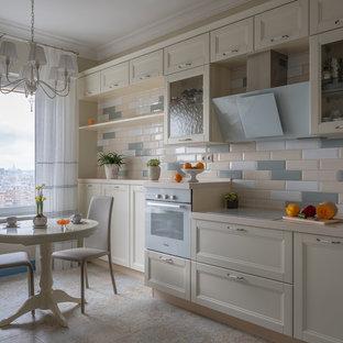 Идея дизайна: маленькая отдельная, угловая кухня в стиле современная классика с фасадами с утопленной филенкой, белыми фасадами, столешницей из акрилового камня, разноцветным фартуком, фартуком из керамической плитки, белой техникой, полом из керамогранита, бежевой столешницей и бежевым полом без острова