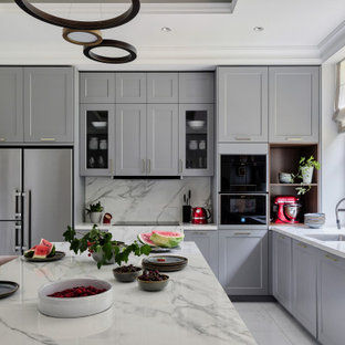 Contemporary enclosed kitchen designs - Example of a trendy u-shaped porcelain tile, white floor and tray ceiling enclosed kitchen design in Saint Petersburg with an undermount sink, raised-panel cabinets, gray cabinets, quartz countertops, white backsplash, quartz backsplash, an island and white countertops