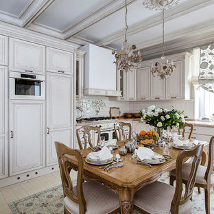 Traditional eat-in kitchen photos - Eat-in kitchen - traditional l-shaped beige floor eat-in kitchen idea in Moscow with gray cabinets, beige backsplash, white appliances and no island