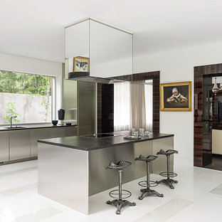 Contemporary open concept kitchen pictures - Inspiration for a contemporary galley open concept kitchen remodel in Moscow with flat-panel cabinets, stainless steel appliances, an island, stainless steel cabinets and window backsplash