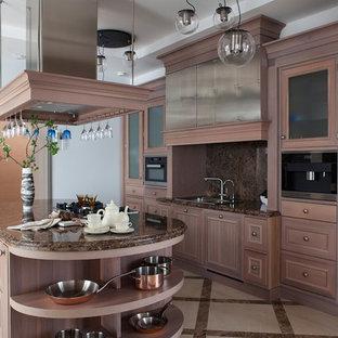 На фото: параллельные кухни в классическом стиле с накладной раковиной, фасадами цвета дерева среднего тона, коричневым фартуком, островом, коричневой столешницей, фасадами с утопленной филенкой и бежевым полом
