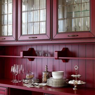 Idée de décoration pour une cuisine tradition avec des portes de placard rouges, une crédence rouge, un placard à porte vitrée et un plan de travail rouge.