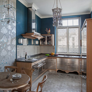 Photo of a mid-sized eclectic l-shaped separate kitchen in Moscow with flat-panel cabinets, stainless steel cabinets, grey splashback, stainless steel appliances, an undermount sink, stone tile splashback, marble floors and no island.